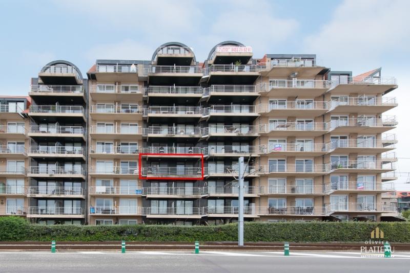 Groot zuidgericht woonappartement (95m²) met ruim terras en uitzicht op de simliduinen.